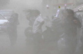Peoples were caught in the unexpected heavy dust/rainstorm at KG Marg CP on May 5 2014 in New Delhi India People had a tough time outside as the...