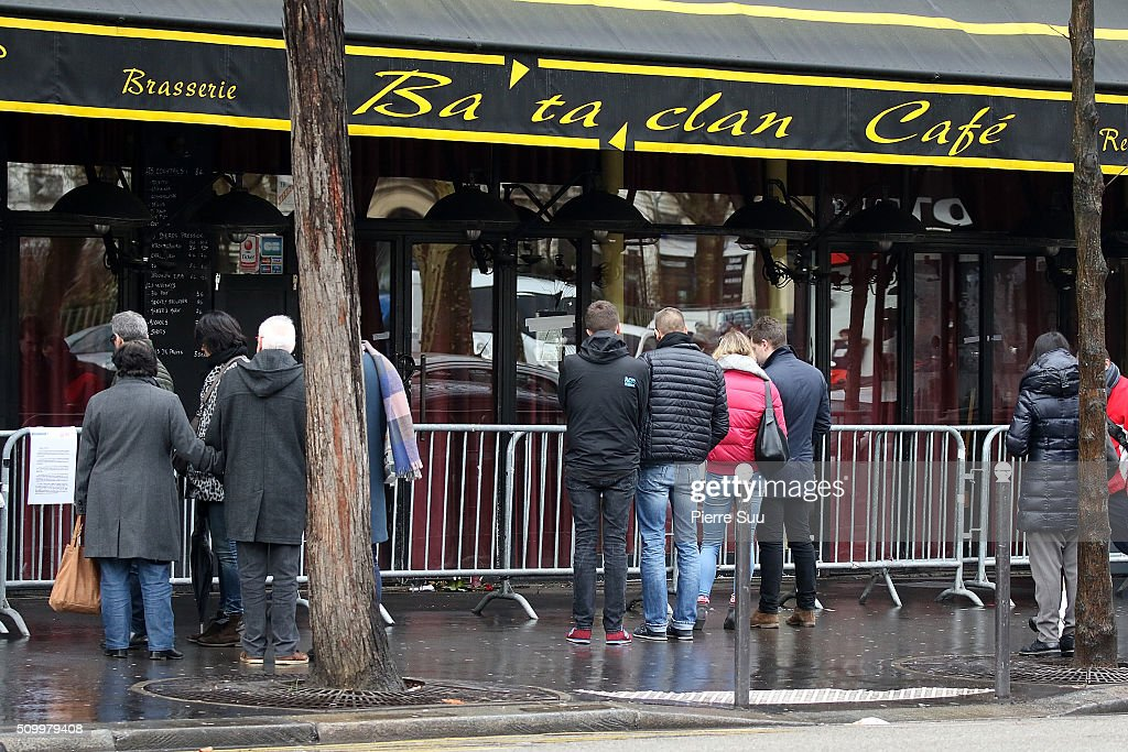 Peoplple stand in front of the Bataclan Cafe on February 13, 2016 in Paris, France. People continue to leave tributes to victims three months after the Paris terrorist attacks.