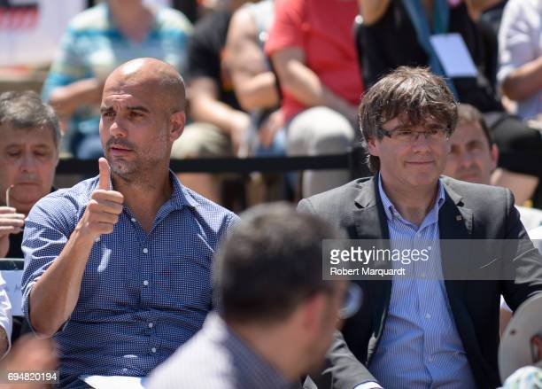 Pep Guardiola and President of Catalunya Carles Puigdemont attend a rally in support of a referendum for Catalunya independence in Montjuic on June...