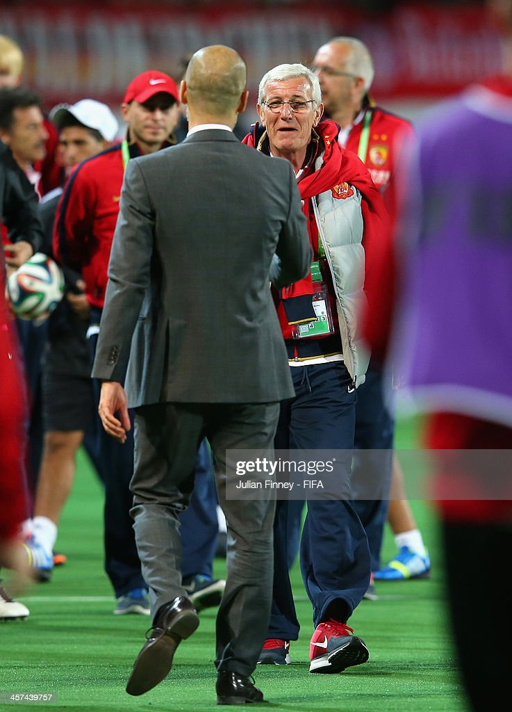 Pep Guardiola, coach of Bayern Muenchen meets with Marcello Lippi the coach of Guangzhou Evergrande FC after the FIFA Club World Cup Semi Final match between Guangzhou Evergrande FC and Bayern Muenchen at the Agadir Stadium on December 17, 2013 in Agadir, Morocco.
