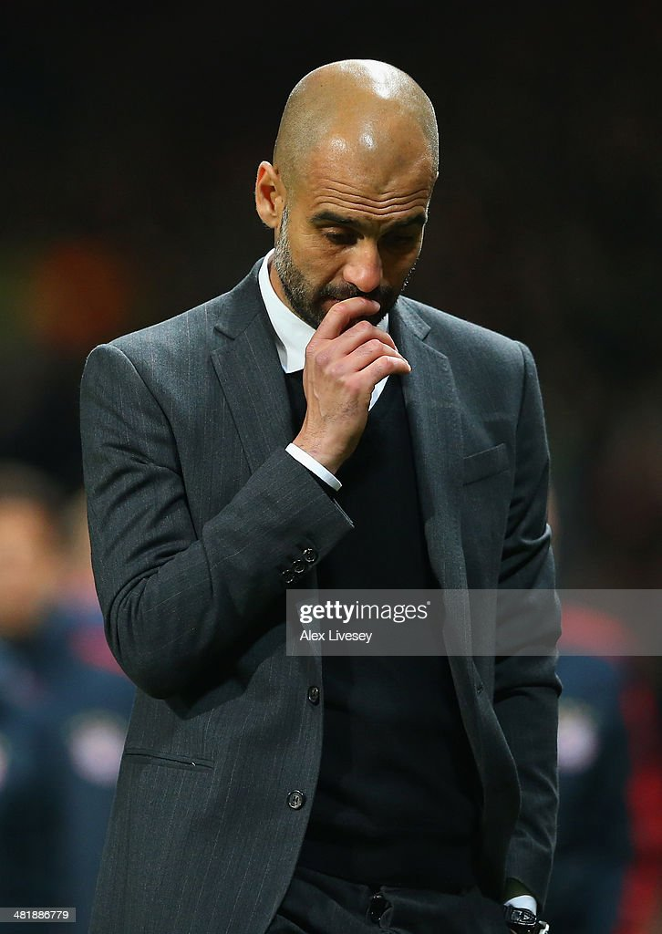 Pep Guardiola head coach of Bayern Muenchen at the end of match during the UEFA Champions League Quarter Final first leg match between Manchester United and FC Bayern Muenchen at Old Trafford on April 1, 2014 in Manchester, England.