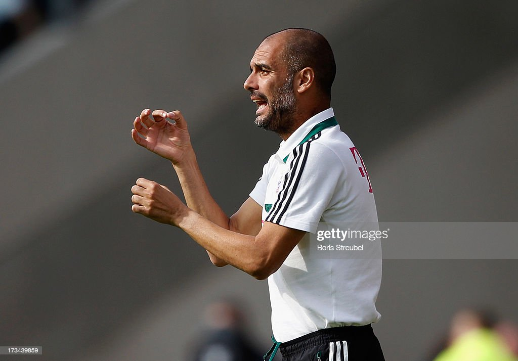 Pep Guardiola, head coach of Bayern Muenchen gestures during the the charity match between Hansa Rostock and FC Bayern Muenchen at DKB-Arena on July 14, 2013 in Rostock, Germany.