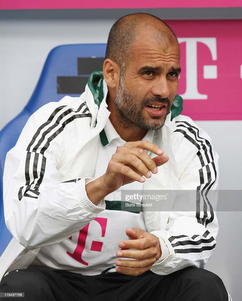 Pep Guardiola, head coach of Bayern Muenchen gestures prior to the the charity match between Hansa Rostock and FC Bayern Muenchen at DKB-Arena on July 14, 2013 in Rostock, Germany.