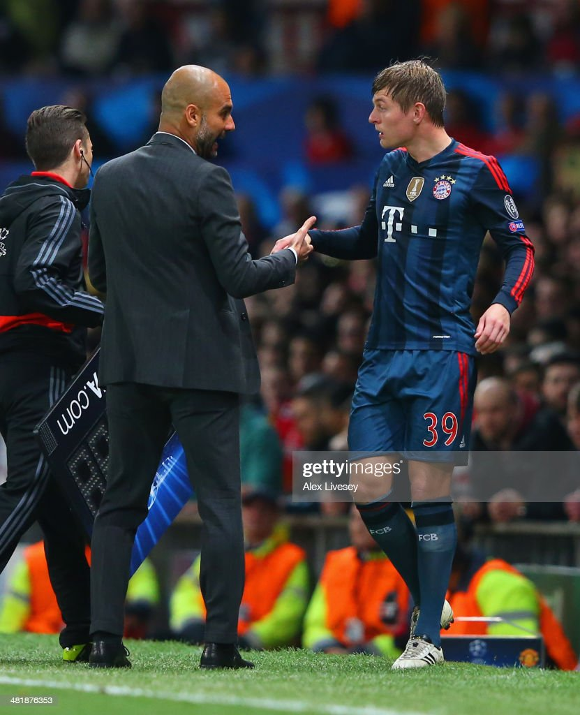 Pep Guardiola head coach of Bayern Muenchen has words with Toni Kroos of Bayern Muenchen during the UEFA Champions League Quarter Final first leg match between Manchester United and FC Bayern Muenchen at Old Trafford on April 1, 2014 in Manchester, England.