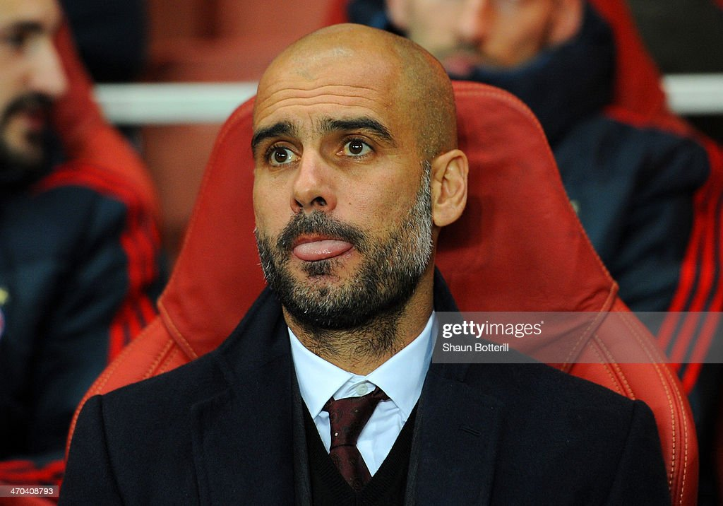 Pep Guardiola head coach of Bayern Muenchen looks on during the UEFA Champions League Round of 16 first leg match between Arsenal and FC Bayern Muenchen at Emirates Stadium on February 19, 2014 in London, England.