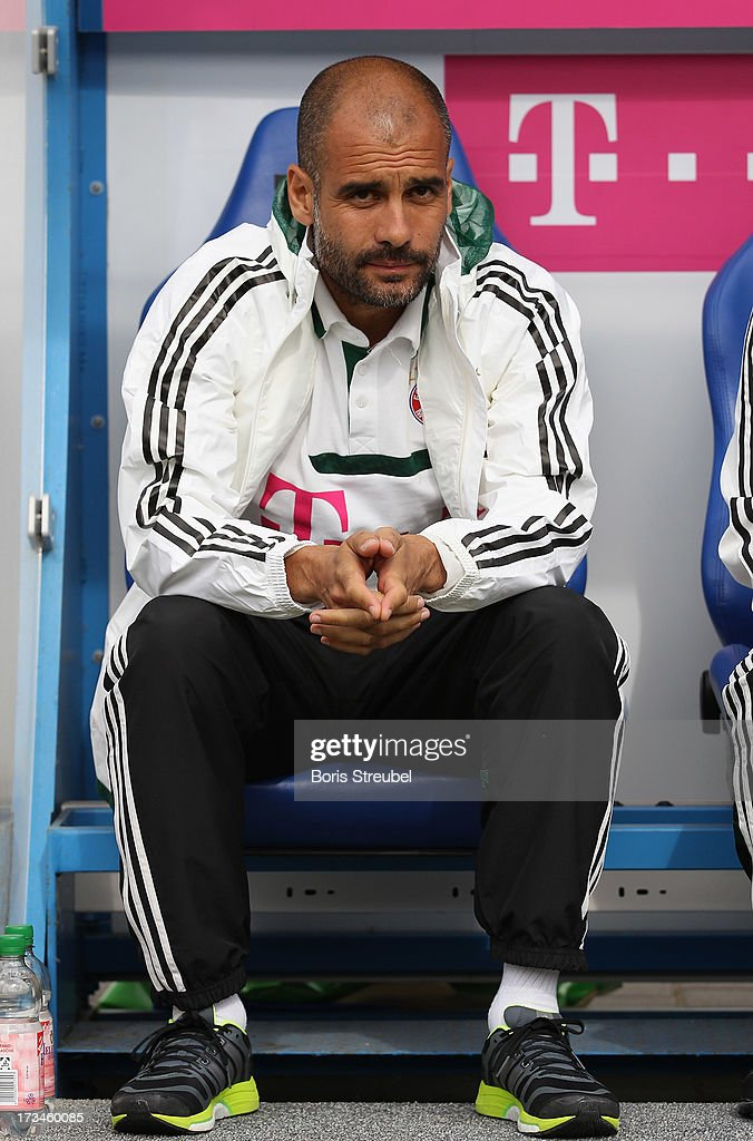 Pep Guardiola, head coach of Bayern Muenchen looks on prior to the the charity match between Hansa Rostock and FC Bayern Muenchen at DKB-Arena on July 14, 2013 in Rostock, Germany.