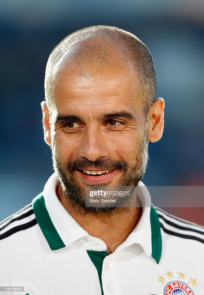 Pep Guardiola, head coach of Bayern Muenchen smiles after the charity match between Hansa Rostock and FC Bayern Muenchen at DKB-Arena on July 14, 2013 in Rostock, Germany.