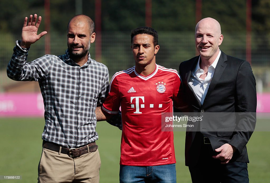 Pep Guardiola (L), head coach of FC Bayern Muechen and sporting director <a gi-track='captionPersonalityLinkClicked' href=/galleries/search?phrase=Matthias+Sammer&family=editorial&specificpeople=555228 ng-click='$event.stopPropagation()'>Matthias Sammer</a> (R) present new recruit Thiago Alcantara after a press conference at Bayern Muenchens headquarter Saebener Strasse on July 16, 2013 in Munich, Germany.