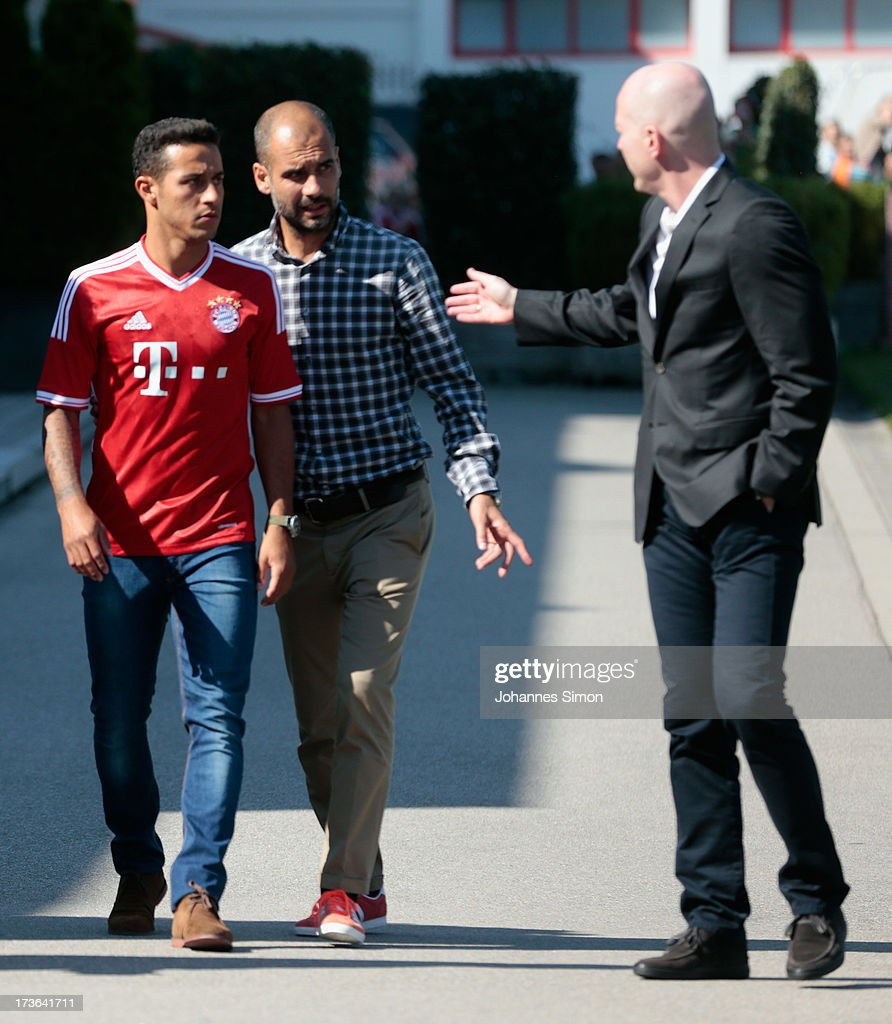 Pep Guardiola (C), head coach of FC Bayern Muechen and sporting director <a gi-track='captionPersonalityLinkClicked' href=/galleries/search?phrase=Matthias+Sammer&family=editorial&specificpeople=555228 ng-click='$event.stopPropagation()'>Matthias Sammer</a> (R) arrive with new recruit Thiago Alcantara after a press conference at Bayern Muenchens headquarter Saebener Strasse on July 16, 2013 in Munich, Germany.