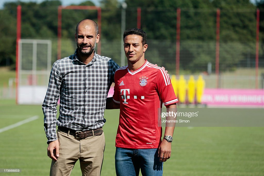 Pep Guardiola (L), head coach of FC Bayern Muechen presents new recruit Thiago Alcantara after a press conference at Bayern Muenchen's headquarters Saebener Strasse on July 16, 2013 in Munich, Germany.