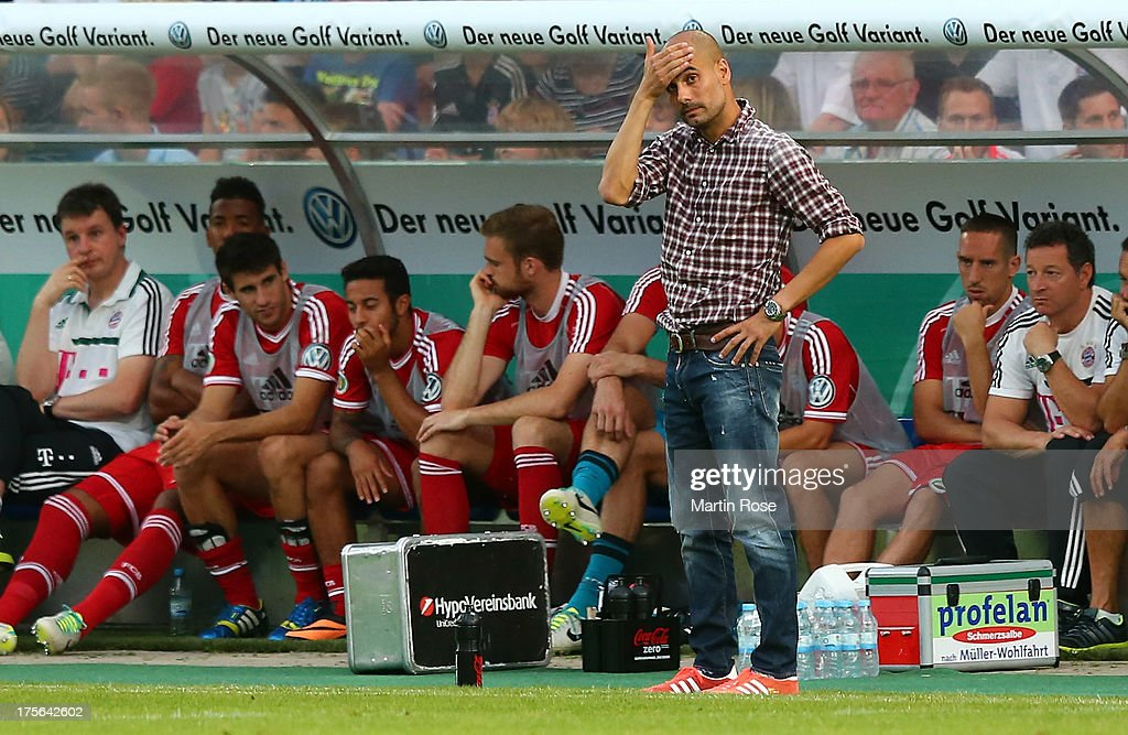 Pep Guardiola, head coach of Muenchen reacts during the DFB Cup first round match between BSV SW Rehden and Bayern Muenchen at osnatel Arena on August 5, 2013 in Osnabrueck, Germany.