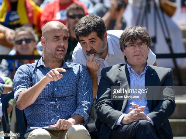 Pep Guardiola Jordi Sanchez and President of Catalunya Carles Puigdemont attend a rally in support of a referendum for Catalunya independence in...