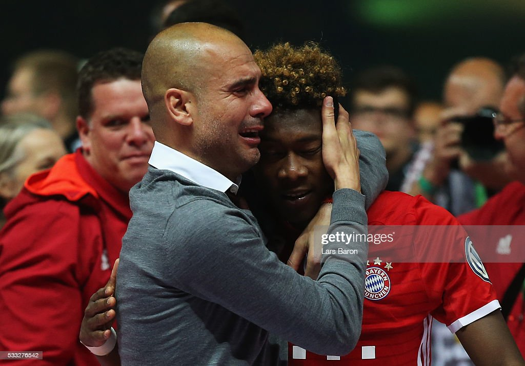 Pep Guardiola of Bayern Muenchen cries while hugging his player David Alaba after winning the DFB Cup Final in a penalty shootout against Borussia Dortmund at Olympiastadion on May 21, 2016 in Berlin, Germany.