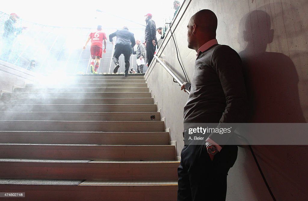 Pep Guardiola of Bayern Muenchen waits in the player's tunnel to celebrate winning the German Championship after the Bundesliga match FC Bayern...