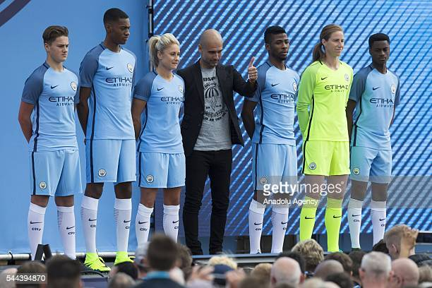 Pep Guardiola stands with players of club during the supporters event at the City Football Academy as he is announced as Manchester City's new...