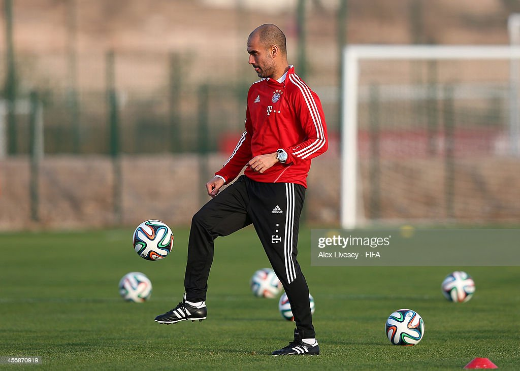 Pep Guardiola the coach of Bayern Muenchen juggles with the ball during a training session at the Agadir Stadium on December 15, 2013 in Agadir, Morocco.