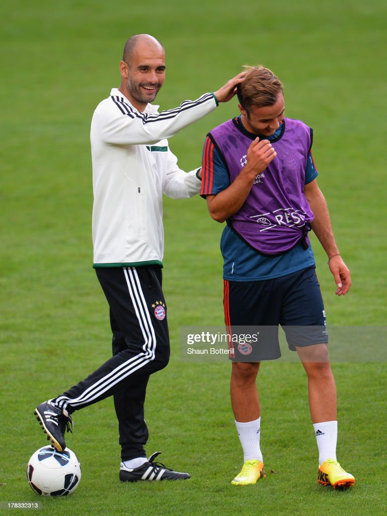 Pep Guardiola the FC Bayern Munchen coach shares a joke with player Mario Gotze during a training session prior to the UEFA Super Cup match between FC Bayern Munchen and Chelsea at Stadion Eden on August 29, 2013 in Prague, Czech Republic.