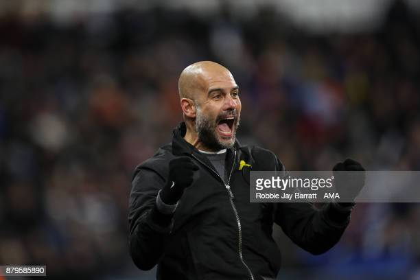 Pep Guardiola the head coach / manager of Manchester City celebrates as Raheem Sterling of Manchester City scores a goal to make it 12 during the...