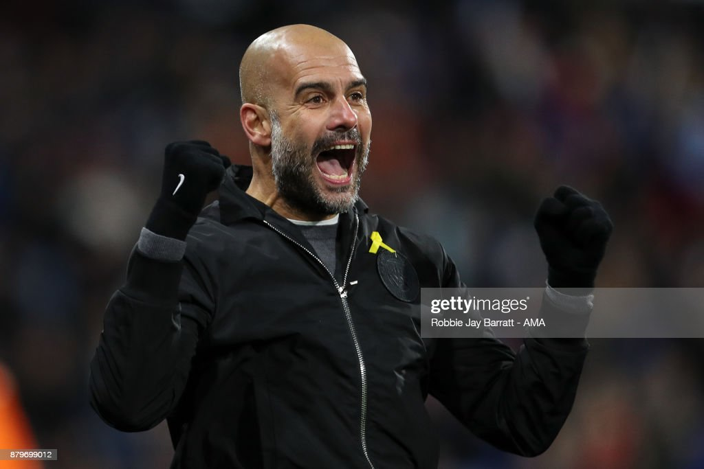 Pep Guardiola the head coach / manager of Manchester City celebrates as Raheem Sterling of Manchester City scores a goal to make it 1-2 during the Premier League match between Huddersfield Town and Manchester City at John Smith's Stadium on November 26, 2017 in Huddersfield, England.