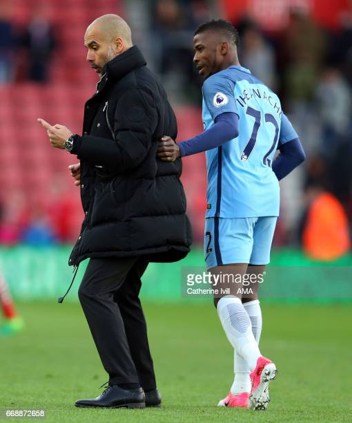 Pep Guardiola the manager of Manchester City speaks with Kelechi Iheanacho of Manchester City after the Premier League match between Southampton and...