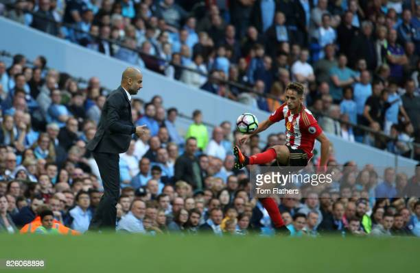 Pep Guardiola watches on as Adnan januzaj controls the ball during the Barclays Premier League match between Manchester City and AFC Sunderland at...