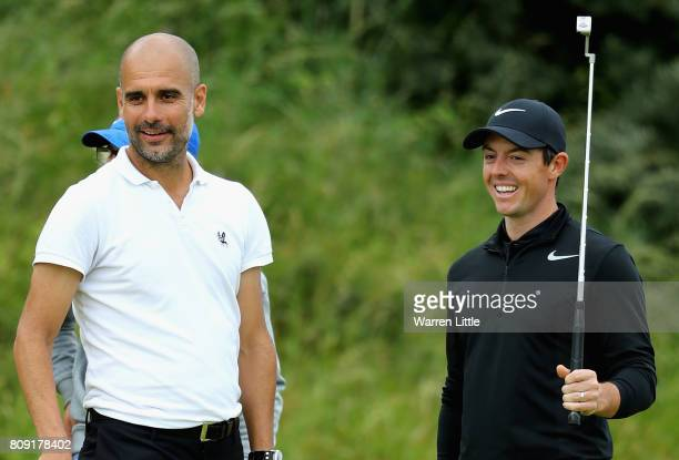 Pep Guardiolla stands with Rory Mcilroy on the 8th green during the ProAm of the Dubai Duty Free Irish Open at Portstewart Golf Club on July 5 2017...