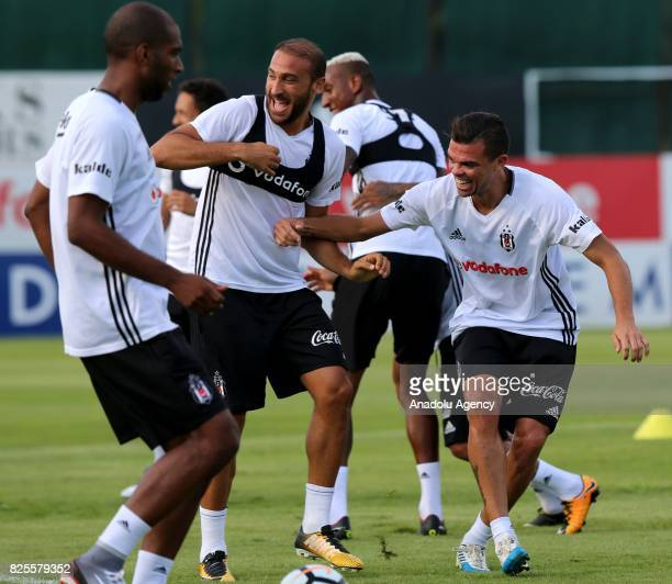 Pepe and Cenk Tosun of Besiktas attend the training session ahead of the Turkcell Super Cup football match between Besiktas and Atiker Konyaspor at...