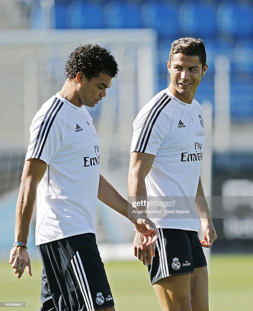 Pepe (L) and <a gi-track='captionPersonalityLinkClicked' href=/galleries/search?phrase=Cristiano+Ronaldo+-+Soccer+Player&family=editorial&specificpeople=162689 ng-click='$event.stopPropagation()'>Cristiano Ronaldo</a> of Real Madrid attend a training session at Valdebebas training ground on September 12, 2013 in Madrid, Spain.
