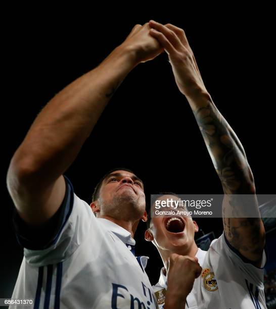 Pepe and James Rodriguez of Real Madrid take a selfie in celebration as they are crowned champions following the La Liga match between Malaga and...