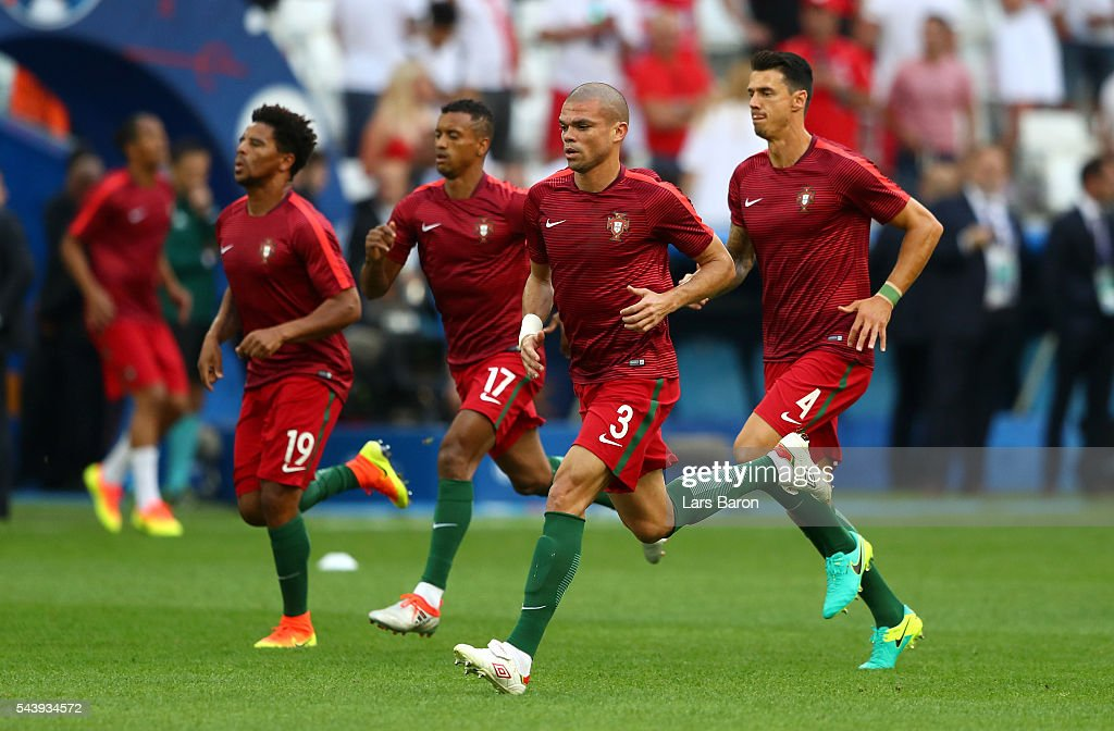 <a gi-track='captionPersonalityLinkClicked' href=/galleries/search?phrase=Pepe+-+Portuguese+Soccer+Player&family=editorial&specificpeople=4401229 ng-click='$event.stopPropagation()'>Pepe</a> (2nd R) and Portugal players warm up prior to the UEFA EURO 2016 quarter final match between Poland and Portugal at Stade Velodrome on June 30, 2016 in Marseille, France.