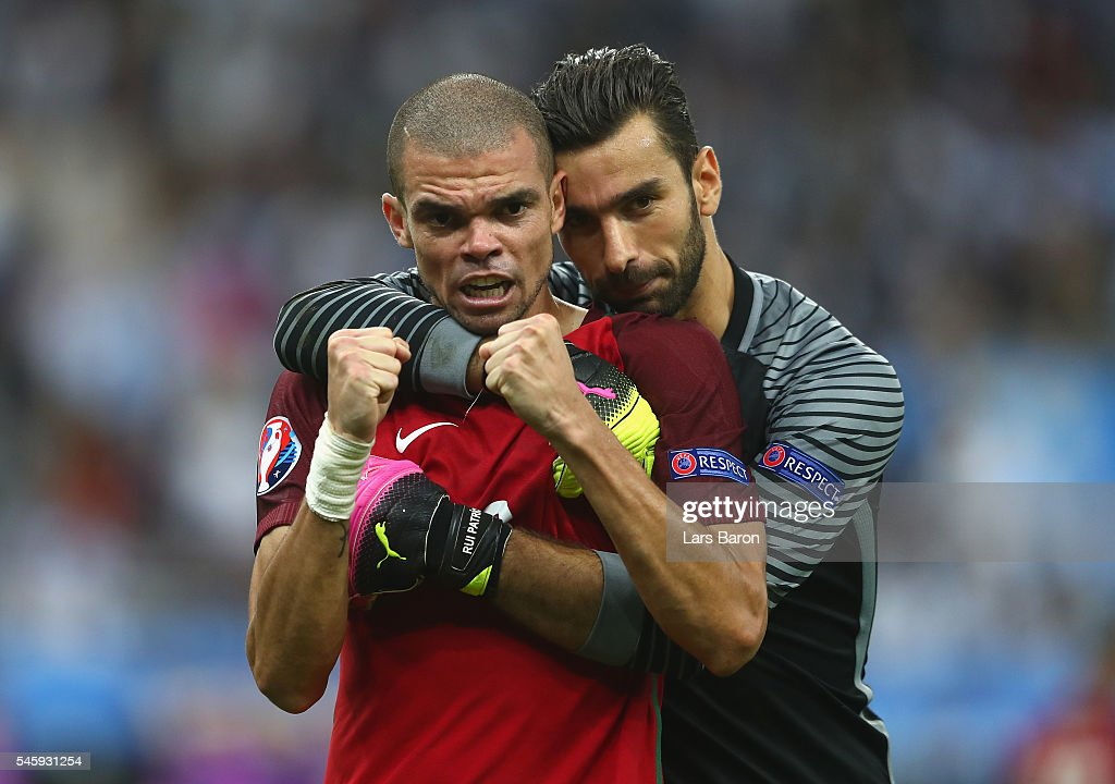 Pepe and Rui Patricio of Portugal celebrate winning at the final whistle during the UEFA EURO 2016 Final match between Portugal and France at Stade de France on July 10, 2016 in Paris, France.