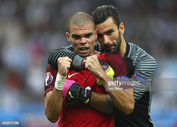Pepe and Rui Patricio of Portugal celebrate winning at the final whistle during the UEFA EURO 2016 Final match between Portugal and France at Stade...