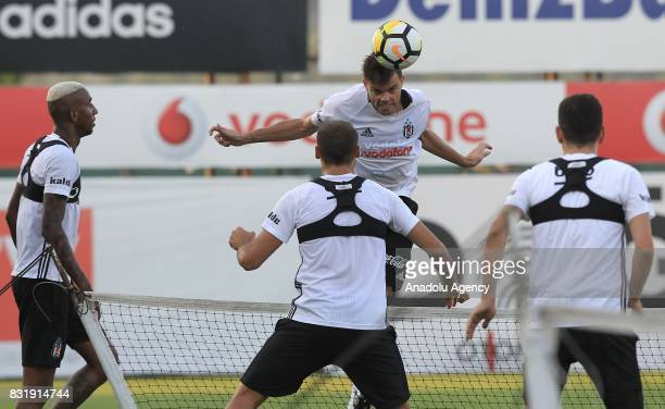 Pepe and Talisca of Besiktas attend a training session ahead of a Turkish Spor Toto Super Lig match between Kasimpasa and Besiktas at Besiktas Nevzat...
