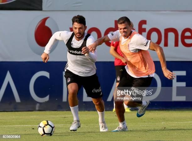 Pepe and Tolgay Arslan of Besiktas attend the training session ahead of the Turkcell Super Cup football match between Besiktas and Atiker Konyaspor...