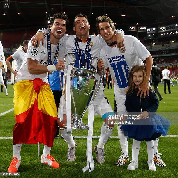 Pepe Cristiano Ronaldo and Fabio Coentrao of Real Madrid lifts the Champions League trophy during the UEFA Champions League Final between Real Madrid...