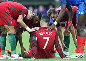 Pepe Luis Nani Adrien Silva of Portugal worry about the injury of Cristiano Ronaldo during the UEFA Euro 2016 final match between Portugal and France...