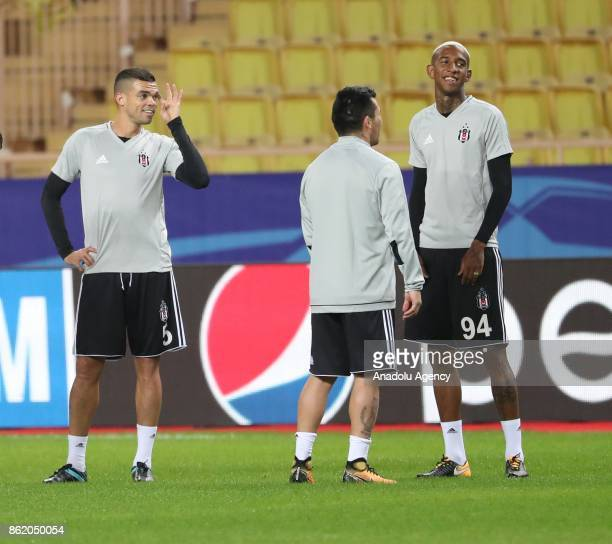Pepe Medal and Talisca of Besiktas attend a training session ahead of UEFA Champions League Group G match between Monaco and Besiktas at Stade Louis...