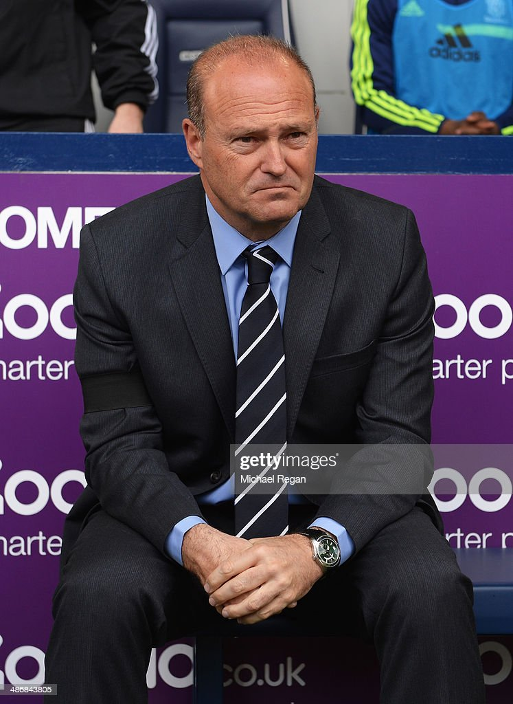 Pepe Mel, manager of West Bromwich Albion wears a black armband as a mark of respect for former Barcelona manager Tito Vilanova during the Barclays Premier League match between West Bromwich Albion and West Ham United at The Hawthorns on April 26, 2014 in West Bromwich, England.