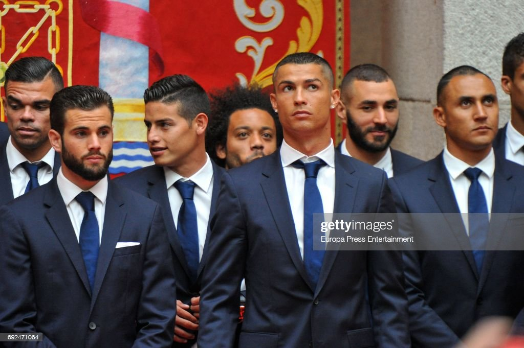 Pepe, Nacho Fernandez, James Rodriguez, Marcelo, Cristiano Ronaldo, Karim Benzema and Keylor Navas celebrate during the Real Madrid celebration the day after winning the 12th UEFA Champions League Final at Casa de Correos on June 4, 2017 in Madrid, Spain.