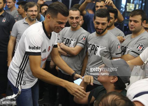 Pepe of Besiktas chats with fans as he participates in an autograph session at 'Kartal Yuvasi' Store at Vodafone Arena in Istanbul Turkey on August...