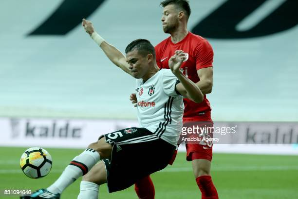 Pepe of Besiktas is in action against Ondrej Celustka of Antalyaspor during a Turkish Spor Toto Super Lig soccer match between Besiktas JK and...