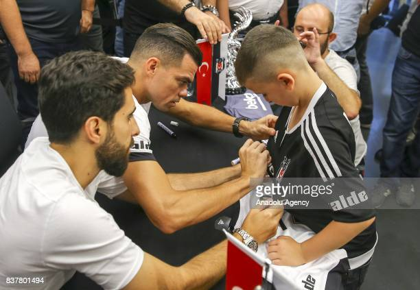 Pepe of Besiktas signs uniforms as he participates in an autograph session at 'Kartal Yuvasi' Store at Vodafone Arena in Istanbul Turkey on August 23...