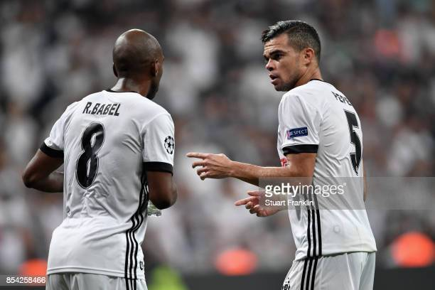 Pepe of Besiktas speaks to Ryan Babel of Besiktas during the UEFA Champions League Group G match between Besiktas and RB Leipzig at Besiktas Park on...