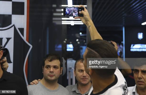 Pepe of Besiktas takes a selfie with fans as he participates in an autograph session at 'Kartal Yuvasi' Store at Vodafone Arena in Istanbul Turkey on...