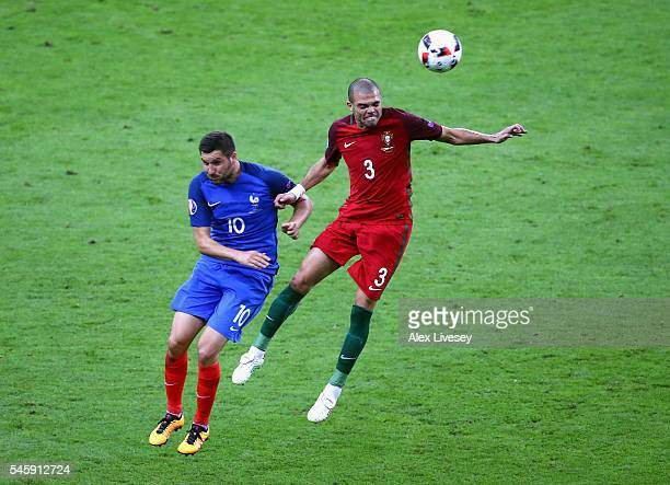 Pepe of Portugal and AndrePierre Gignac of France compete for the ball during the UEFA EURO 2016 Final match between Portugal and France at Stade de...