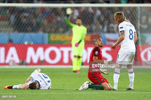 Pepe of Portugal and Birkir Bjarnason of Iceland argue during the UEFA EURO 2016 Group F match between Portugal and Iceland at Stade GeoffroyGuichard...