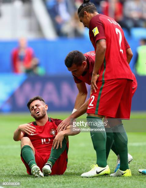 Pepe of Portugal and Cristiano Ronaldo of Portugal check that Bernardo Silva of Portugal is okay during the FIFA Confederations Cup Russia 2017 Group...