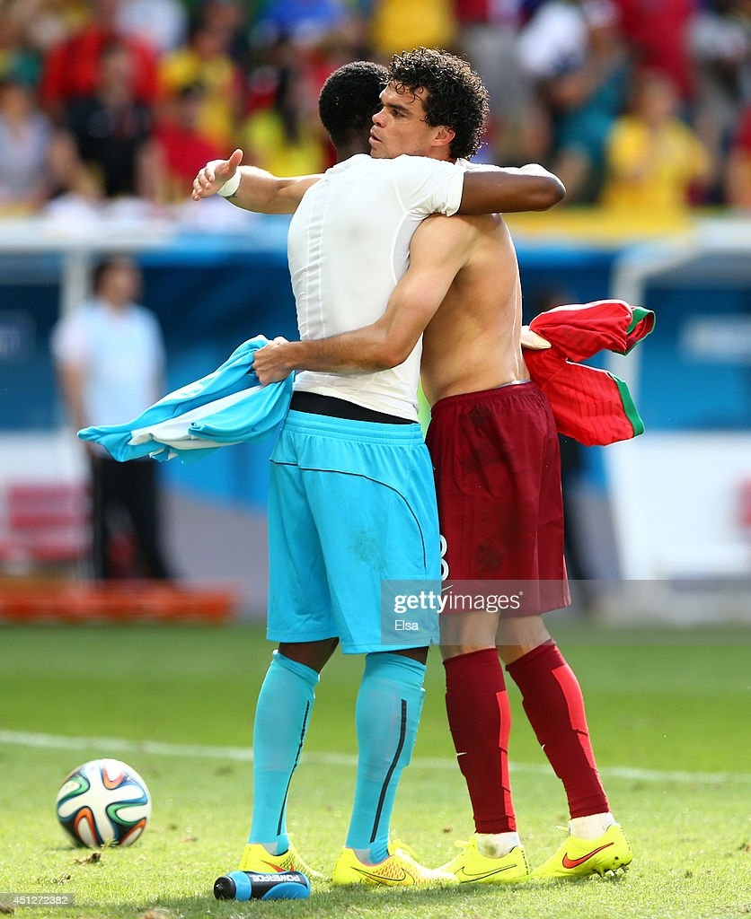 Pepe of Portugal and Fatawu Dauda of Ghana hug after the 2014 FIFA World Cup Brazil Group G match between Portugal and Ghana at Estadio Nacional on June 26, 2014 in Brasilia, Brazil.