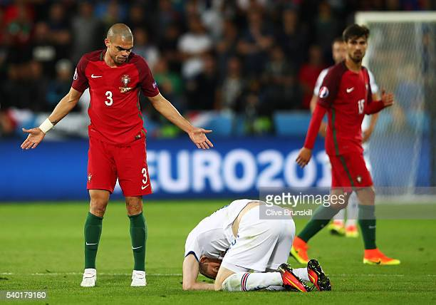 Pepe of Portugal appeals after colliding with Jon Dadi Bodvarsson of Iceland during the UEFA EURO 2016 Group F match between Portugal and Iceland at...