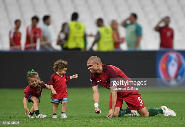 Pepe of Portugal celebrates his team's win with his daughters after the UEFA EURO 2016 quarter final match between Poland and Portugal at Stade...